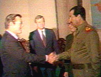 Saddam Hussein meeting with , at the time 's special envoy to the , during a visit to ,  in . Video frame capture, see the complete video (http://www.misc-web.pwp.blueyonder.co.uk/nsa_archive_media.html)