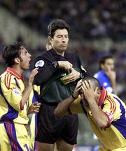 A player is cautioned by the referee